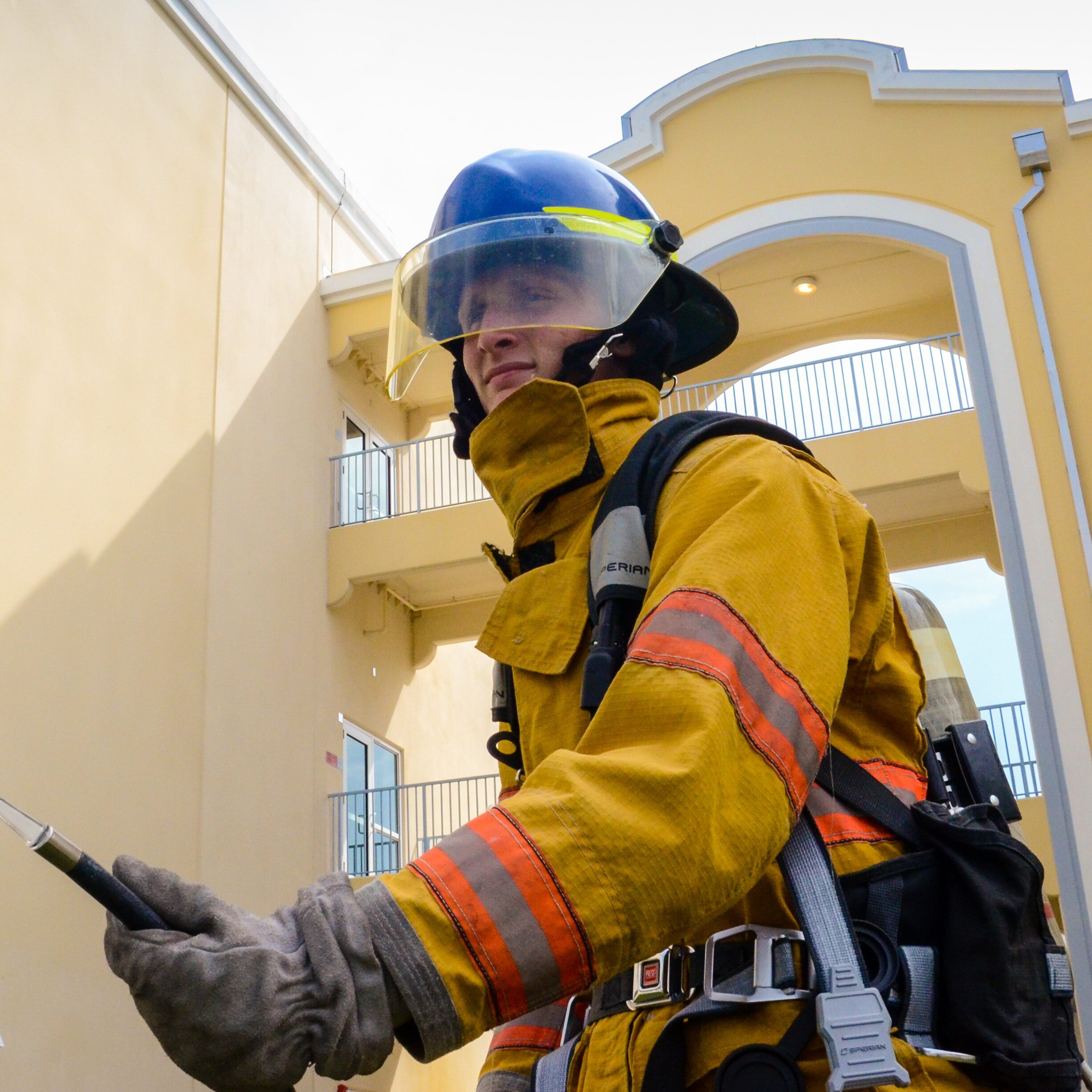 photo-of-firefighter-beside-building-896568